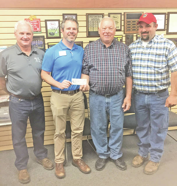 Members of Lions Club of Good Hope are shown presenting a check in the amount of $2,000 to Greenfield Exempted Village Board of Education President Eric Zint. The donation will go toward scholarships. Pictured, from left, are Mike Cullom, Zint, David Ross and Jarrod Posey.