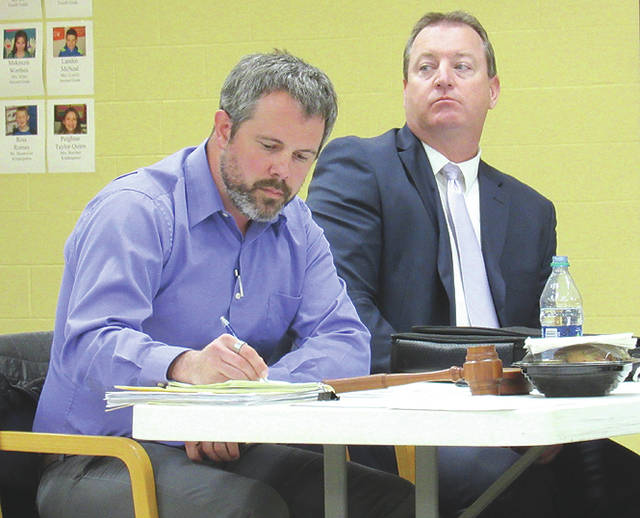 Greenfield schools superintendent Joe Wills, right, is pictured with board of education president Eric Zint at Monday's school board meeting.