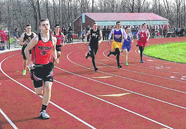 Runners from Miami Trace, McClain, Eastern, Hillsboro, Washington, Whiteoak and Lynchburg-Clay come around the first turn at the start of the boys 4x800-meter relay. Pictured in front is Cody Everhart. Pictured in back (l-r): Ben Bales, C. Young, J. Atwood, Gabri Chiossi, K. Morris and Brian Shanahan.
