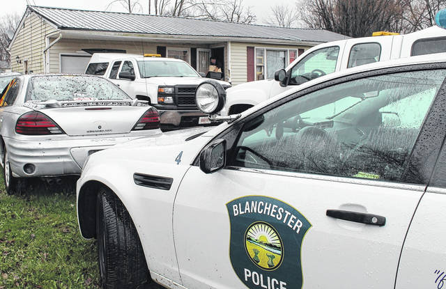 The dog warden removes dogs from the home at 7485 State Route 123 in Blanchester.