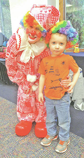 A clowning around scene during story time at the Greenfield Public Library.