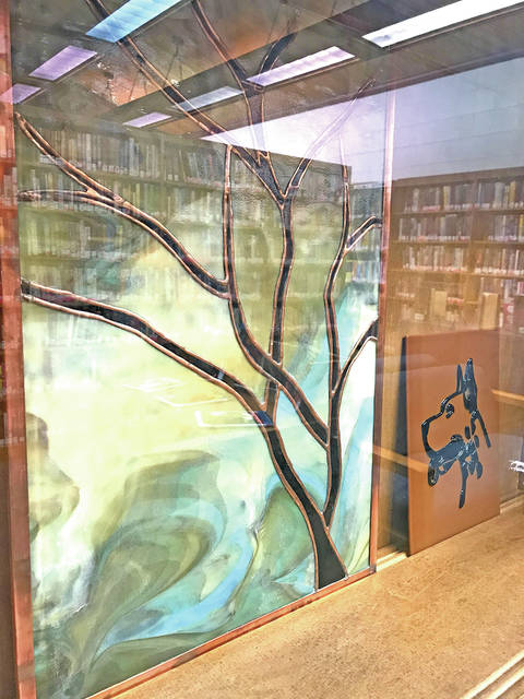 Pictured are two of Scott Gallimore's pieces currently on display at the Hillsboro library.