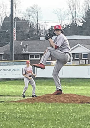 Hillsboro's Luke Magulac winds up for a pitch at Shaffer Park on Thursday where the Indians battled the Chillicothe Cavaliers in FAC baseball action.