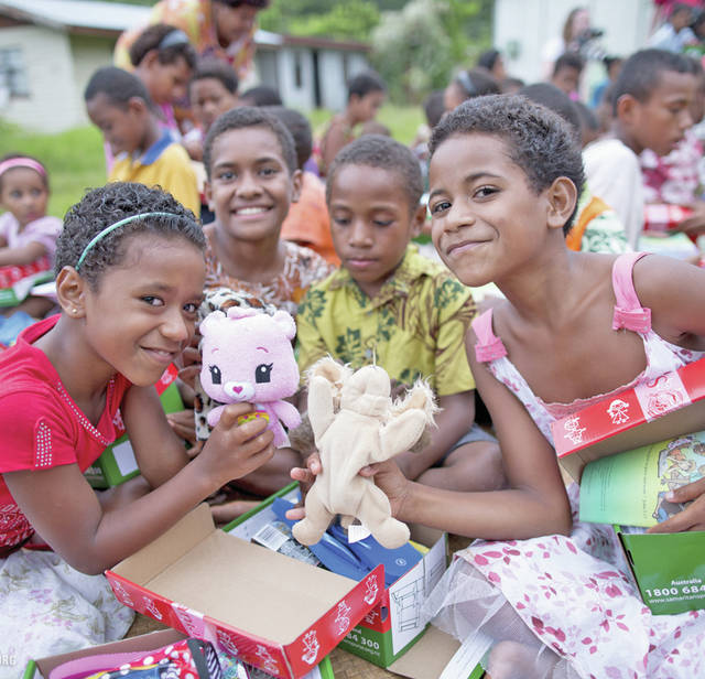 Children in Fiji are pictured after receiving Operation Christmas Child shoeboxes.