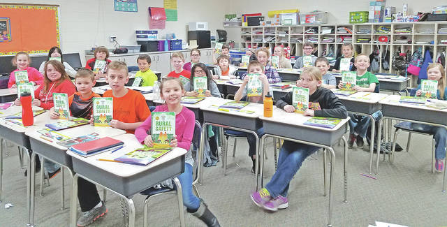"""Students in Jennifer Fraysier's third grade class at Bright Local Elementary School are pictured with their """"Rural Safety"""" books."""