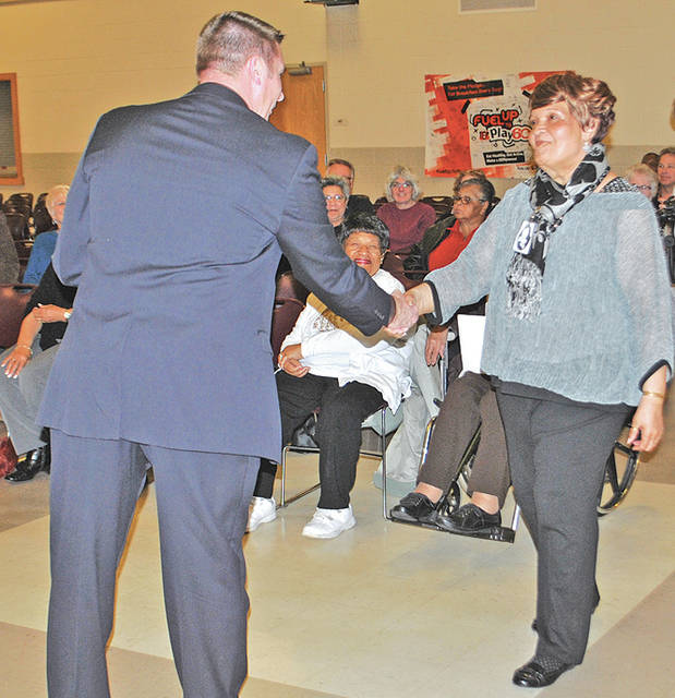 Hillsboro Superintendent Tim Davis shakes the hand of Eleanor (Curtis) Cumberland in honor of her family's role more than 60 years ago in helping force the integration of the Hillsboro schools.