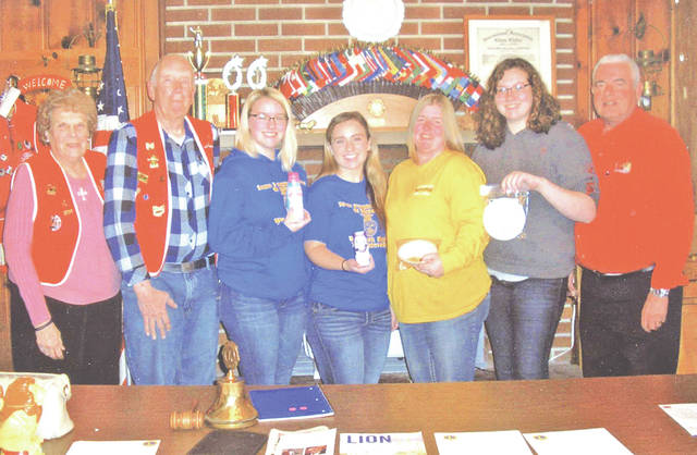 The Lynchburg Lions Club held its monthly dinner meeting March 26 at the Lions Club Building. Special guests for the evening were members of the Lynchburg-Clay FFA Dairy Products Skills Team that won first place in a state FFA contest recently. The team will represent Ohio in the national contest later this year. The members discussed how the contest is conducted and all the skills and facts that must be known to compete. Pictured, from left, are Lion Janet Florance, Lion Bob Roth, FFA team members Kelsey Arnett and Makayla Creed, team coach Jo Heather Arnett, team member Kara Williams and Lion Jim Faust.