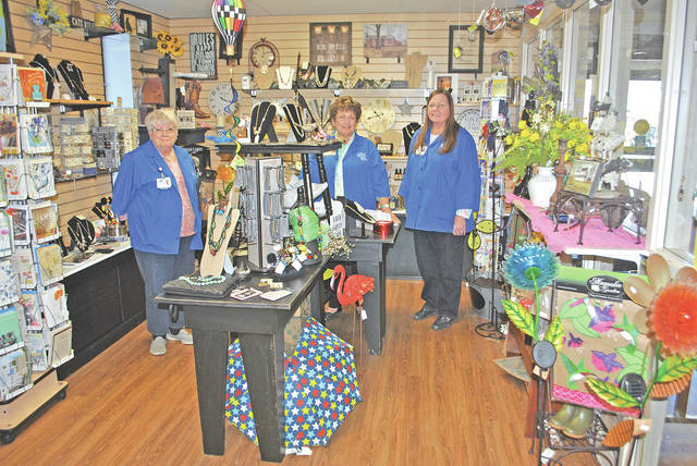 Volunteers Shelba Grim, Vicki Unger and Karen Yeager are pictured inside the gift shop at Adena Greenfield Medical Center.