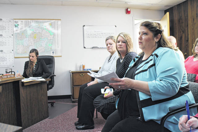 Alternatives to Violence Center Director Julie Brassel, right, speaks to the Highland County Board of Commissioners on Thursday. Also shown are Hillsboro Office Manager Dara Gullette, seated left of Brassel, and Fiscal Manager Teri Cragwall, left of Gullette, and Commision Clerk Nicole Oberrecht, far left.