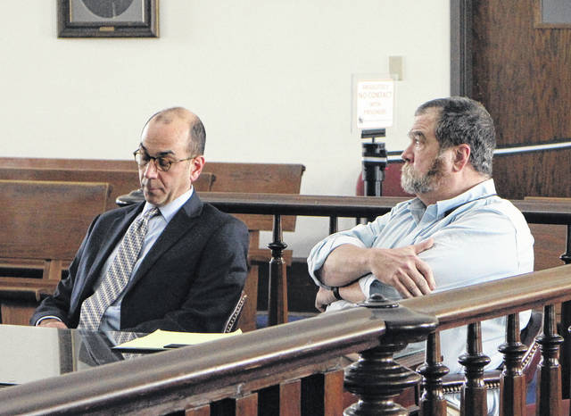Dr. Timothy Manuel, right, sits in court with defense attorney Edward Perry at a hearing earlier this year in Highland County Common Pleas Court.