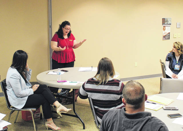 Jennifer Benson, an Ohio certified prevention consultant, speaks to members of the Highland County Drug Abuse Prevention Coalition on Thursday at the North High Business Center in Hillsboro.
