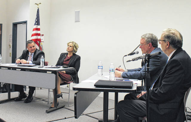 From left, Shane Wilkin speaks Tuesday evening at Southern State Community College as Beth Ellis listens. Wilkin and Ellis, the Republican candidates for representative of the 91st District, took the stage to tackle political issues in a discussion moderated by Times-Gazette Editor and Publisher Gary Abernathy, seated at left at the table on the right, and Wilmington News Journal Editor Tom Barr, seated at right.