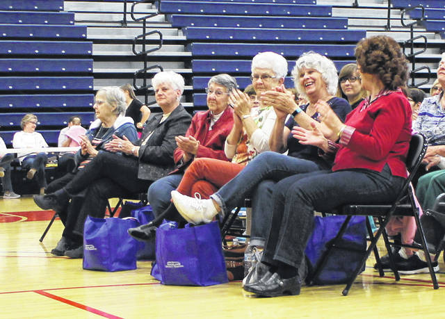 Attendees at The Times-Gazette's 30th Salt Homemakers Show clap along to a hit from local entertainer Herb Day on Thursday at Southern State Community College in Hillsboro.