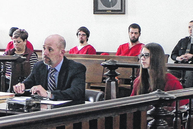 Faith Scott, right, sits in Highland County Common Pleas Court on Wednesday with defense attorney J.D. Wagoner, left.