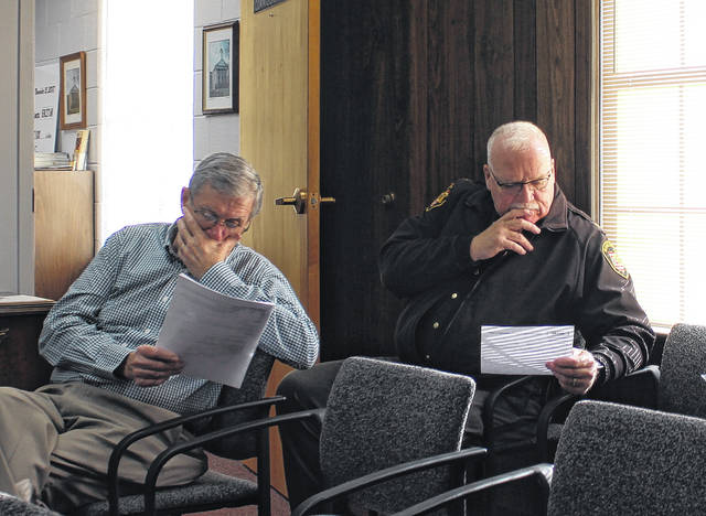 Highland County Auditor Bill Fawley and Sheriff Donnie Barrera appear deep in thought during a brief Highland County Board of Commissioners meeting on Wednesday. The commissioners approved two routine financial resolutions and discussed attending an economic outlook forecast event in Wilmington next Wednesday, but chose to forego the event to hold their weekly meeting at its regular time of 8:30 a.m. No further action was taken.