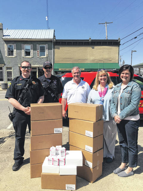 Staff with the Paint Creek Joint EMS/Fire District and REACH for Tomorrow pause for a photo Friday in Greenfield with 636 Narcan kits, a donation from REACH to local fire departments.