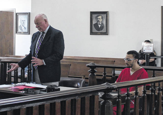 Kasey Wright, right, sits in Highland County Common Pleas Court on Monday for a sentencing hearing. Also shown is defense attorney Bill Armintrout.