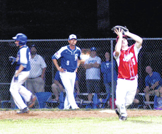 Hillsboro first baseman Kelton Anderson squeezes the ball tightly in his glove for the third out in the top of the seventh inning on Monday at Rannow Field in The Plains during the Southeast District Semi-Final game against Gallia Academy.