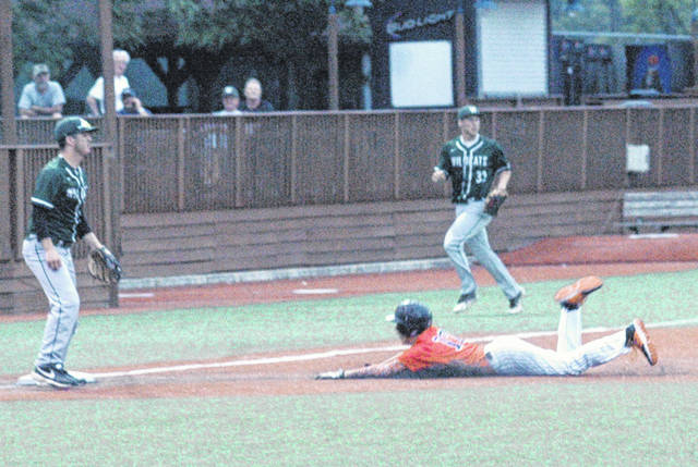 Whiteoak's Chase Carraher slides head first into third base on Wednesday at Paints Stadium in Chillicothe where Whiteoak battled Waterford in the District Finals.