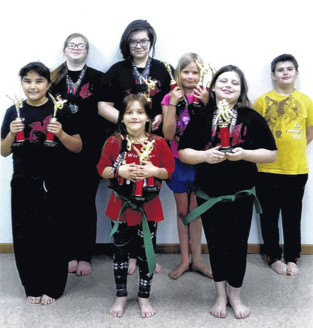 Members of the Cross County Bushido Club pose for a photo with their trophies and medals following a successful tournament in Lynchburg, Ohio at the first annual Bushido Karate Tournament.