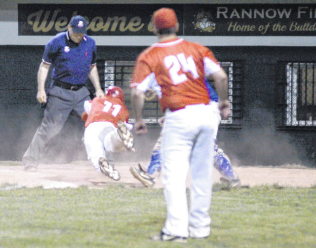 Hillsboro freshman Ryan Scott dives for home plate on Monday at Athens High School where the Indians defeated Gallia Academy 1-0 in eight innings to advance to the Southeast District Final on Wednesday, May 16, at Ohio University.