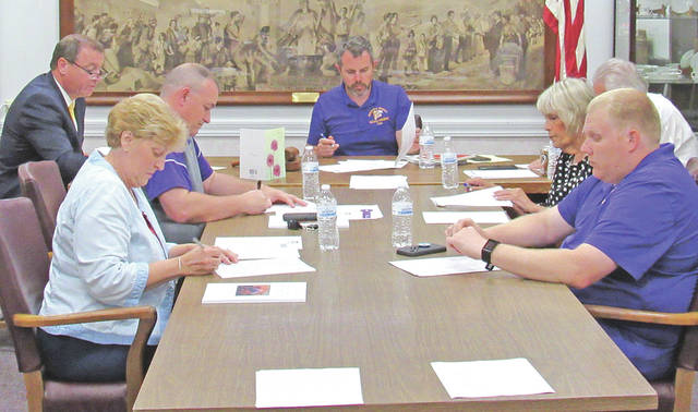 Pictured at Monday's Greenfield School Board meeting (l-r) are superintendent Joe Wills, board members Sandy Free and Jason Allison, board president Eric Zint, board members Marilyn Mitchell and Charley Roman, and treasurer Joe Smith (behind Mitchell).
