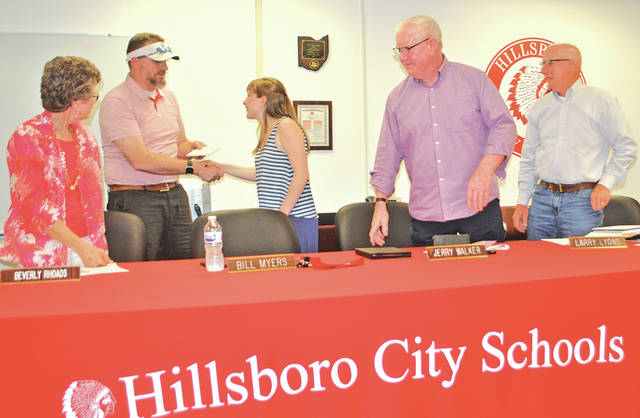 Isabelle Bourne, center, the outgoing student representative on the Hillsboro Board of Education, receives thanks Monday from board members, from left, Beverly Rhoads, Bill Myers, Jerry Walker and Larry Lyons during her final meeting. Board member Tom Milbery is not shown in the photo.