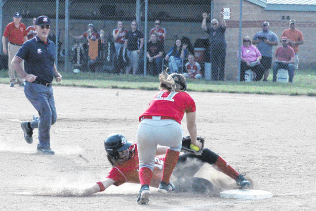 Fairfield's Lyndee Spargur (12) slides into third base for a triple as Piketon's Madison Metzger rushes to apply the tag in the bottom of the third inning Friday at Fairfield High School. The Lady Lions were battling the Lady Redstreaks in the Division III Sectional Final softball showdown.