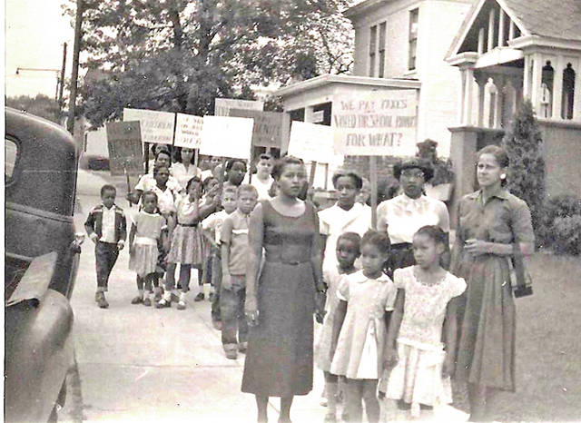 This photo shows the Lincoln School Marching Mothers and their children on their daily march to the Hillsboro schools in the mid 1950s.