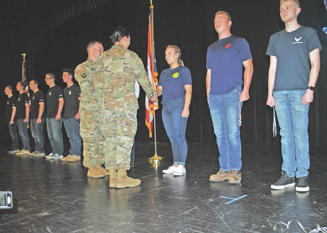 Hillsboro High School students and U.S. Army officers are pictured Tuesday during a military ceremony at the school designed to remind students that serving their country is a viable career option.