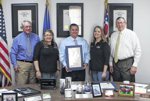 The Highland County Board of Commissioners on Wednesday proclaimed the week of May 7-11 In-Demand Jobs Week. Shown from left are Commissioner Jeff Duncan, Rhonda Fannin, director of workforce services at OhioMeansJobs, Commissioner Shane Wilkin, Janet Taylor, center attendant at OhioMeansJobs, and Commissioner Terry Britton.