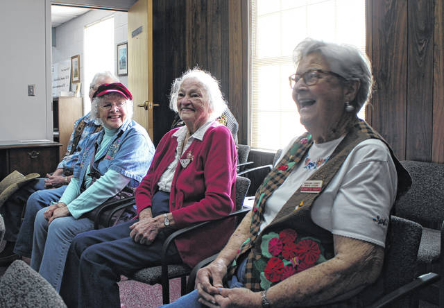 From left, Donna Sizemore-Haynes, Eloise Harrison and Jeannette Knauff, Highland County Senior Citizen Center volunteers, share a laugh at a Wednesday commissioners meeting.