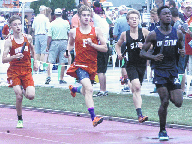 Fairfield's Andrew Davis, center, runs down the front stretch on Friday in the D III 4x800-meter relay at Jesse Owns Memorial Stadium as part of the 2018 OHSAA State Track and Field Meet.