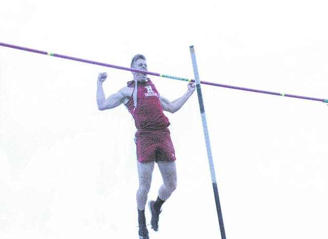 Austin Goolsby flexes his muscles after clearing the bar in the D II Pole Vault at the State Track and Field Meet in Columbus on Friday. Goolsby finished in second with a height of 14-10.