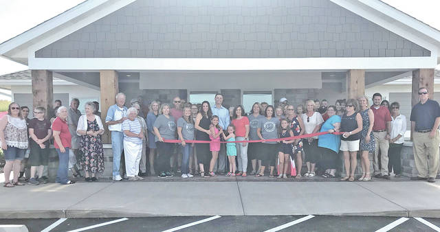 Dr. Joseph Jordan (center in light colored shirt) and his staff held an open house event June 15 to announce the opening of his office in Hillsboro – Buckeye Dentistry. The office is located at 7625 Pea Ridge Road.