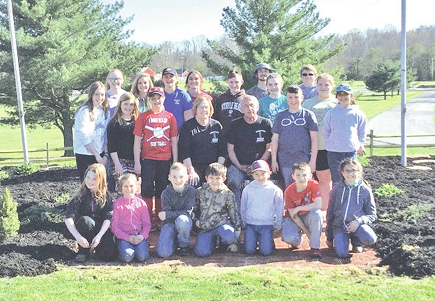 Fab Five 4-H Club members and other volunteers are pictured with Liberty Park Veteran's Memorial caretakers Rick Tipton and Sherry Hixson.