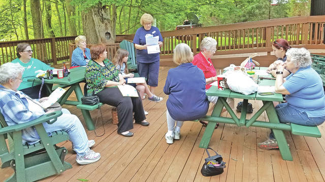 Members of the Waw-wil-a-way Chapter of the DAR are pictured during their June 2 meeting at the Highland Nature Sanctuary.
