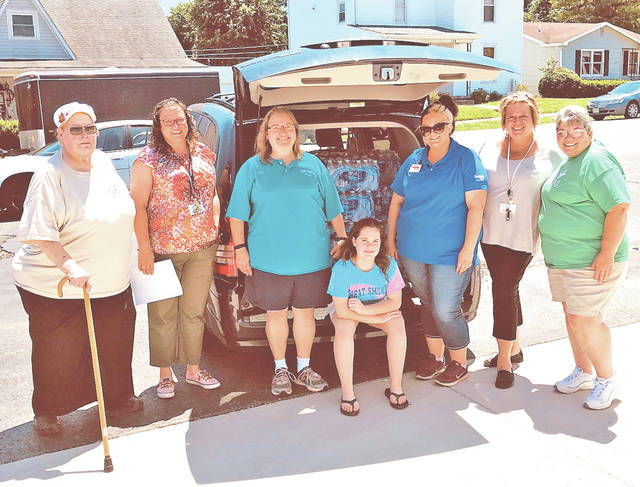 Edgewood Manor of Greenfield employees challenged their executive director, Susan Michaelson, to donate Drinks for Dovetail. For every employee contribution, Edgewood Manor of Greenfield would match one-to-one cases of water donated to the children of KAMP Dovetail. As it happened, the generosity moved Michelle Shumate of Save-A-Lot grocery store in Greenfield to donate an additional 20 cases of water for a grand total of 75 cases. Pictured, from left, are Janice Shuff, KAMP Dovetail volunteer; Heidi Morris, EMG business office manager; Joy Polstra, KAMP Dovetail staff/group leader; Lydia Polstra, KAMP Dovetail volunteer; Michelle Shumate of the Greenfield Save-A-Lot; Elaine B. Williams, EMG social services director; and Rhonda Campbell, KAMP Dovetail donations coordinator.