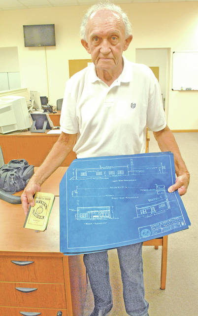 "During The Times-Gazette 200th birthday celebration Monday, Hillsboro resident Bob Dunlap brought in the original plans for the newspaper's former location in the 200 block of South High Street in Hillsboro. He also had the ""time book"" his father, Robert ""Todd"" Dunlap used while managing the project. Bob's grandfather, Clyde Dunlap, also worked on the building that was built in 1955 for the Hillsboro Publishing Company. Inside the time book are these words penned by Todd Dunlap: ""Very modern. Hot water & A/C. Glazed tile to the ceiling except in offices and warehouse. Prefinished brick paneling in offices – acoustical tiled ceilings."""
