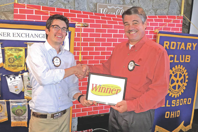 Rotarian Craig Edgington, right, won the Hillsboro Rotary's joke contest Tuesday in an upset victory over renowned comedy maven Rob Sharp. Edgington emerged victorious after several rounds of competition involving various Rotarians telling jokes of high, medium and low quality. Edgington received his award from Rotary President Reid Sharp, left.
