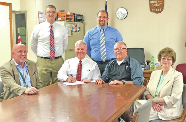 Pictured (standing, l-r) are David Richey and Nick Brown; (seated, l-r) Jim Brady, Mike Pell, Randy Carson and Jo Anna Carraher.