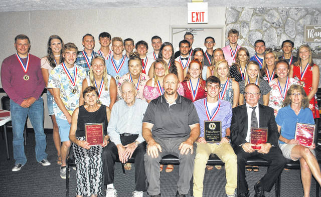 Shown seated, from left, are Bonnie Parr, wife of The Times-Gazette Highland County Athletic Hall of Fame inductee Willard Parr Jr.; Willard Parr Sr.; John Parr, son of Willard Parr Jr.; Britton Haines, winner of the 2018 Times-Gazette Highland County Scholar-Athlete Award; hall of fame inductee Mike Willson; and hall of fame inductee Kay Cummings. Also shown are the 2018 scholar-athletes.