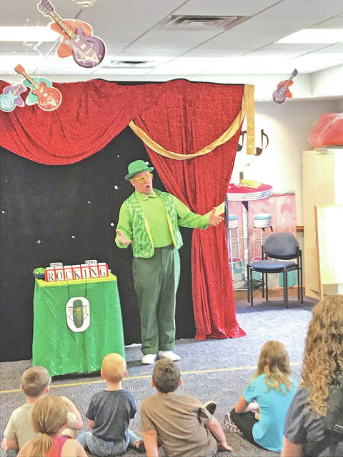 Mister Pickles and library visitors are shown during a Tuesday morning program at the Greenfield library.