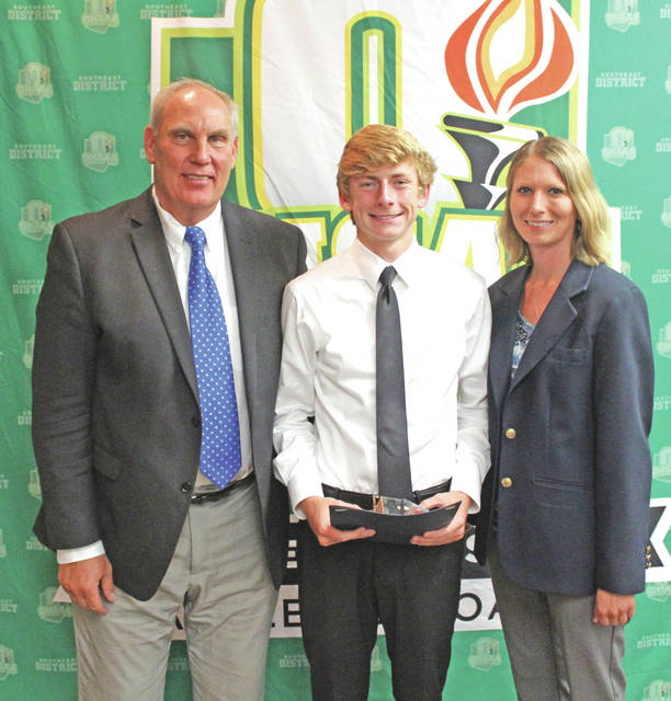 Matthew Mangus, a 2018 Fairfield High School graduate, is pictured with Jerry Snodgrass (right) OHSAA executive director; and Stephanie Evans (left) representing the SEDAB, at a recent banquet in Jackson.