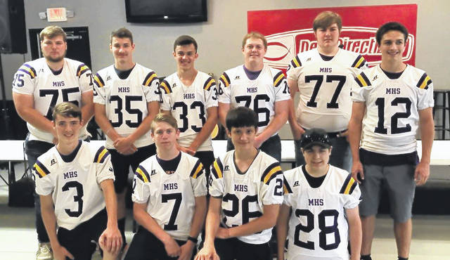A group of McClain football players are pictured at New Directions in Greenfield on Friday afternoon after helping to put away items that were left from a rummage sale earlier in the day. Pictured back row (l-r): Trevor Tite, Alex Snyder, Matt Bliss, Jacob Parks, Sam Colburn and Blake Gall. Front row (l-r): Braden Wright, Tanner Van Dyke, Grant Pennington and Chris McGinnis.