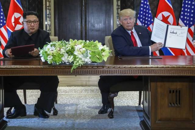 President Donald Trump and North Korea's Kim Jong Un held a momentous summit Tuesday, with Kim agreeing to denuclearization. Trump said U.S. sanctions would remain in place for now.