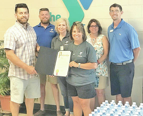 Hillsboro City Councilman Justin Harsha (left) presents a prclmation to Highland County YMCA staff in recognition of the facility's 15th anniversary. Also pictured are Kellie Kiser (front, right) executive director Highland County YMCA; Chris Tracy, senior program director; Debbie Vance, member services coordinator; Sheila Hinton, executive director Clermont County YMCA; and Tom Morris YMCA instructor.