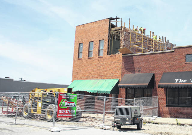 Demolition crews took advantage of clear weather on Thursday to continue tearing down the Armintrout building on Gov. Trimble Place. Demolition work is expected to be completed Friday, June 22.