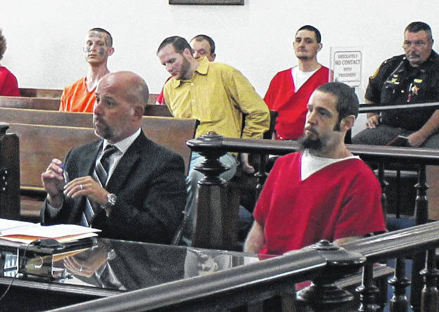 Ian Andrew Cluxton, right, sits in Highland County Common Pleas Court on Thursday with attorney J.D. Wagoner, left.