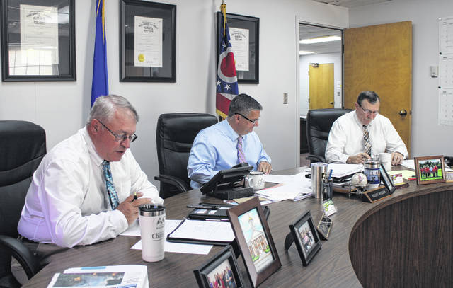 Shown from left are Highland County commissioners Jeff Duncan, Shane Wilkin and Terry Britton at their weekly meeting on Wednesday.